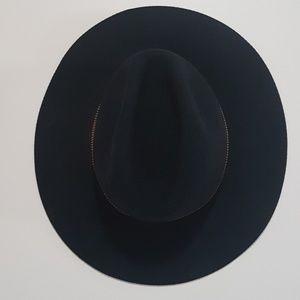 deLux adjustable black wool hat with gold trim.
